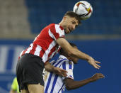 Athletic Bilbao's Yeray Alvarez, top, and Real Sociedad's Alexander Isak jump to head the ball during the final of the 2020 Copa del Rey, or King's Cup, soccer match between Athletic Bilbao and Real Sociedad at Estadio de La Cartuja in Sevilla, Spain, Saturday April 3, 2021. The game is the rescheduled final of the 2019-2020 competition which was originally postponed due to the coronavirus pandemic. (AP Photo/Angel Fernandez)