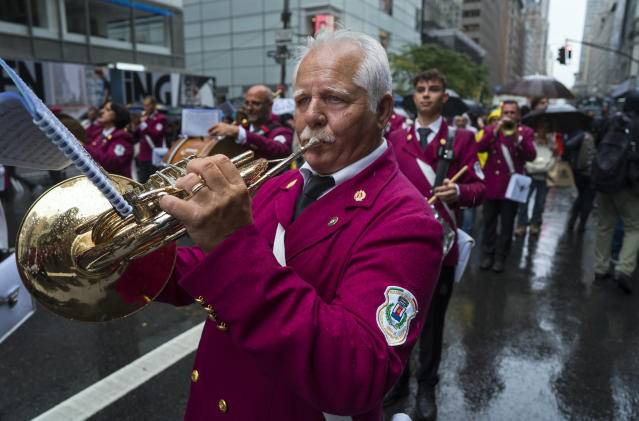 <p>A band representing Castellammare del Golfo, Italy, marches along 5th Avenue in New York during the annual Columbus Day Parade on Monday, Oct. 9, 2017. (Photo: Craig Ruttle/AP) </p>
