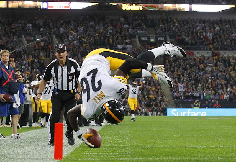 Pittsburgh Steelers running back Le'Veon Bell flips over as he scores a touchdown during the NFL football game against Minnesota Vikings at Wembley Stadium, London, Sunday, Sept. 29, 2013. (AP Photo/Sang Tan)