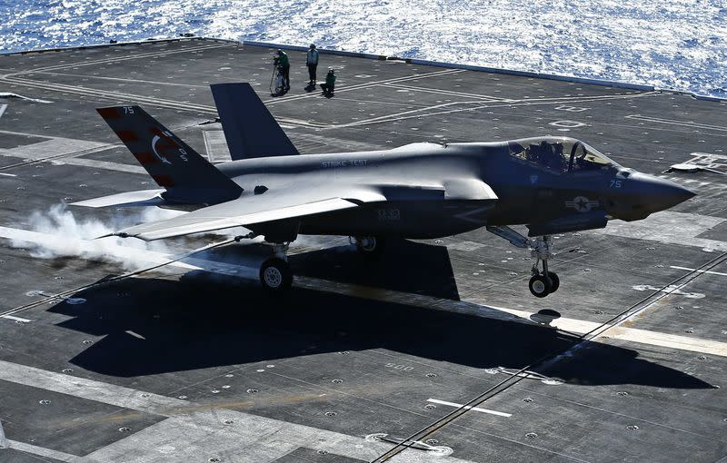 Dyckman makes a successful landing of a F-35C on an aircraft carrier using its tailhook system, while off the coast of California