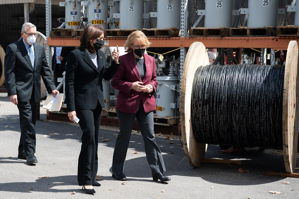 US Vice President Kamala Harris walks with US Senator Maggie Hassan (D-NH) (R) Democrat of New Hampshire, to a listening session on broadband internet at the New Hampshire Electric Co-op in Plymouth, New Hampshire, April 23, 2021, as she travels to the state to promote the administration's economic plans. (Photo by SAUL LOEB / AFP) (Photo by SAUL LOEB/AFP via Getty Images)