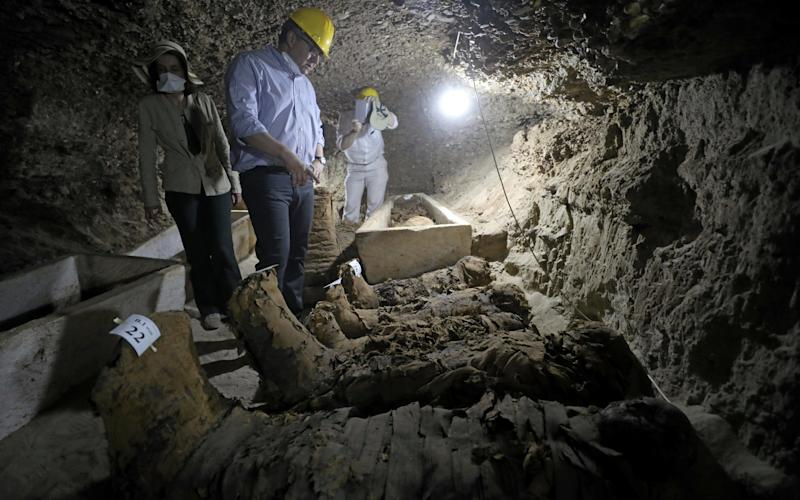 Egyptian Minister of Antiquities Khaled Al-Anani inside a newly discovered burial site in Minya, Egypt. - Credit: AFP