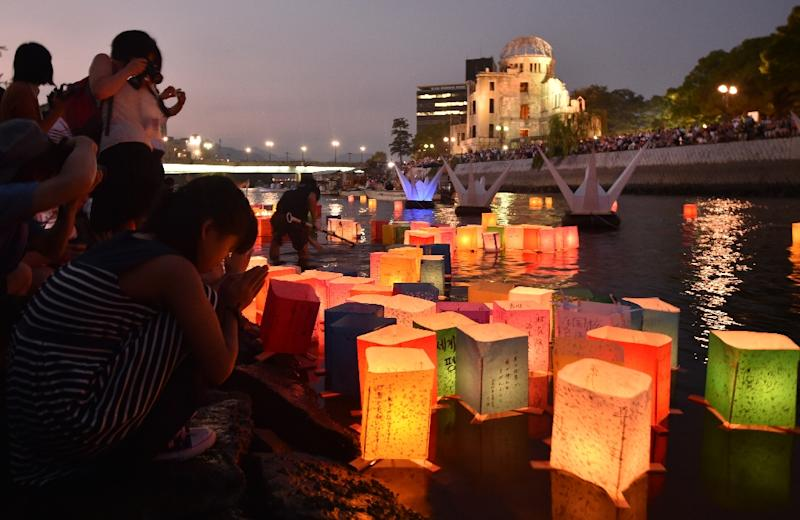 Paper lanterns floating on the Motoyasu River in front of the Atomic Bomb Dome in Hiroshima on August 6, 2015 (AFP Photo/Kazuhiro Nogi)