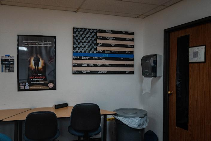 "A thin blue line flag poster on display in an out-of-use classroom.<span class=""copyright"">Jovelle Tamayo for TIME</span>"