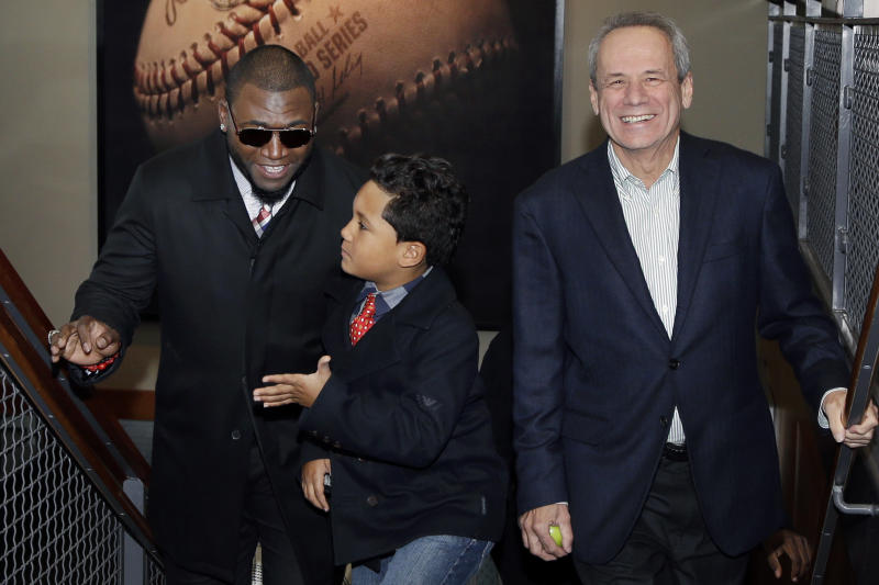 Boston Red Sox's David Ortiz, left, arrives with his son D'Angelo, 8, and team President Larry Lucchino for a baseball news conference, Monday, Nov. 5, 2012, at Fenway Park in Boston. Ortiz announced that he has finalized a $26 million, two-year contract, which includes bonuses that could raise the value to $30 million. (AP Photo/Elise Amendola)