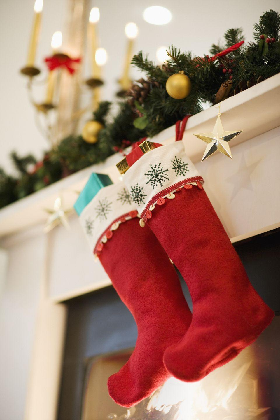 """<p>Hanging stockings takes all of five minutes, so why not extend the fun by crafting your own? You don't need any knitting skills. For an easy activity even your preschoolers can do, buy simple stockings and supplies like glitter puff paint, then let everyone get to work personalizing their own. </p><p><a class=""""link rapid-noclick-resp"""" href=""""https://www.amazon.com/Meriwoods-Christmas-Stockings-Personalized-Decorations/dp/B08F2C3HWZ?tag=syn-yahoo-20&ascsubtag=%5Bartid%7C10072.g.34454588%5Bsrc%7Cyahoo-us"""" rel=""""nofollow noopener"""" target=""""_blank"""" data-ylk=""""slk:SHOP STOCKINGS"""">SHOP STOCKINGS</a></p>"""