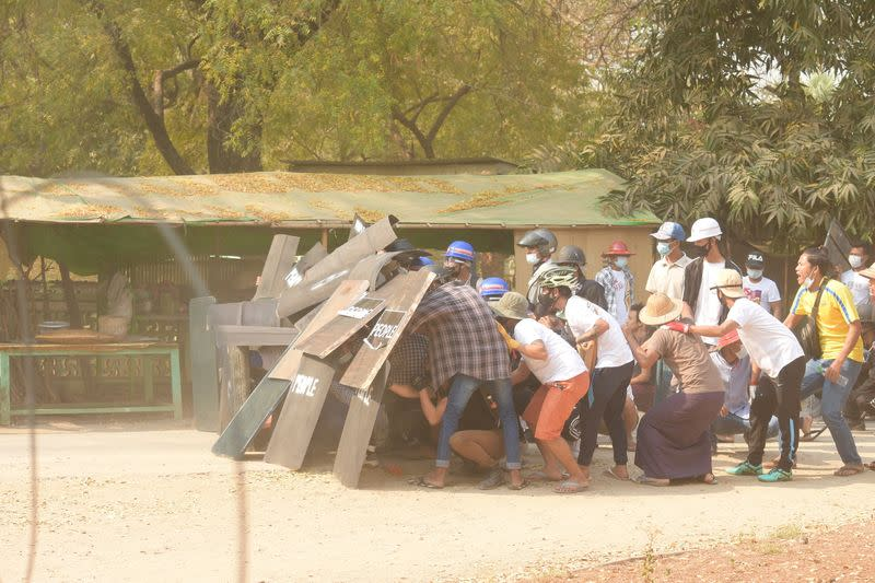 Protesters create a shield formation in Nyaung-U
