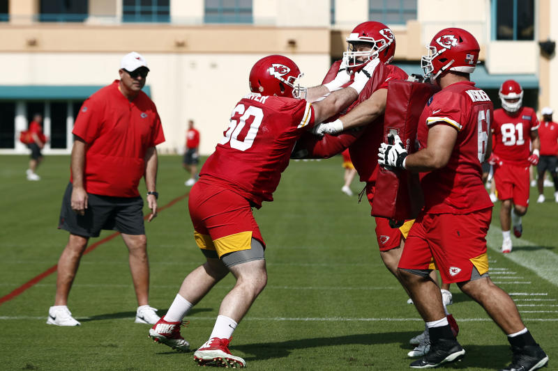 Kansas City Chiefs offensive guard Ryan Hunter (60) runs drills with offensive guards Nick Allegretti (73) and Stefen Wisniewski (61) during practice on Thursday, Jan. 30, 2020, in Davie, Fla., for the NFL Super Bowl 54 football game. (AP Photo/Brynn Anderson)