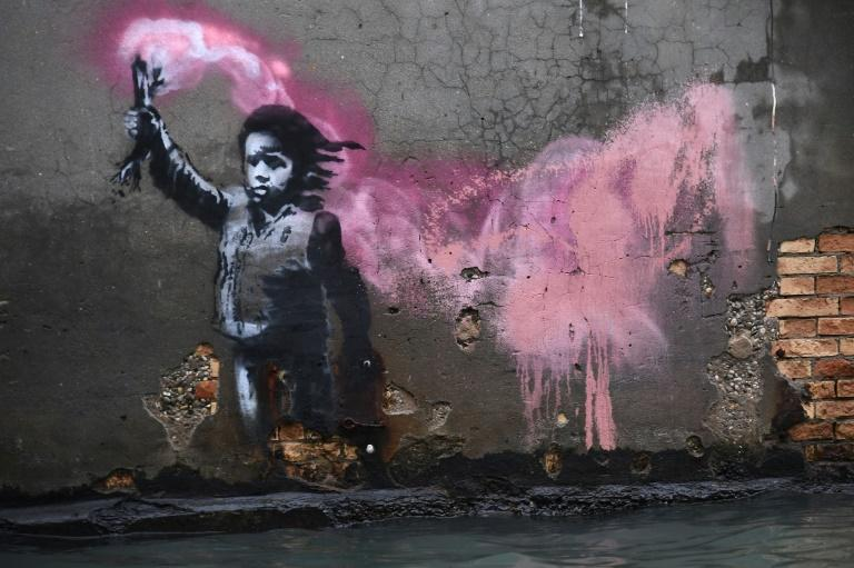 Street artist Banksy's work in Venice portraying a migrant child wearing a life jacket and holding a flare