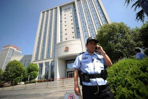 """Security guards stand outside the Intermediate People's Court in Hefei, Anhui province on August 7. The wife of a former Chinese top politician at the heart of a scandal that has rocked the ruling Communist Party has admitted murdering a British businessman and blamed her actions on a """"mental breakdown"""", state media reported Friday"""