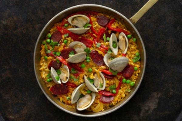 <p><strong>Weeknight Chorizo and Clam Paella</strong></p> <p>Recipe by Bon Appetit Test Kitchen</p> <p>4 servings</p> <p>Active: 25 minutes</p> <p>Total: 50 minutes</p>