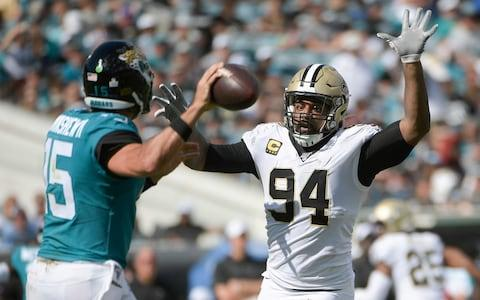 New Orleans Saints defensive end Cameron Jordan (94) tries to block a pass by Jacksonville Jaguars quarterback Gardner Minshew, left, during the second half of an NFL football game, Sunday, Oct. 13, 2019, in Jacksonville - Credit: AP