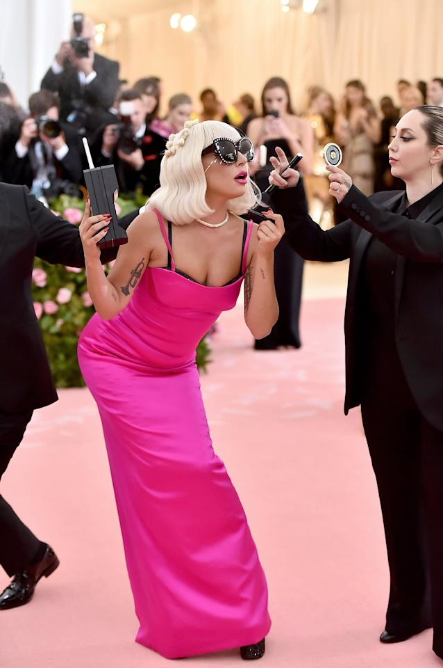 """<p>Wearing Linda Farrow sunglasses and holding an old-school cell phone, <a class=""""sugar-inline-link"""" title=""""Latest photos and news for Lady Gaga"""" href=""""https://www.popsugar.com/Lady-Gaga"""" target=""""_blank"""">Lady Gaga</a> struck a pose in her third outfit change on the Met Gala red carpet.</p>"""