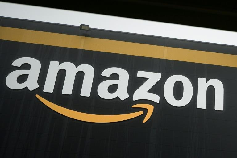 Amazon could deliver satellite-based internet service to the US and other parts of the world without reliable access through its Project Kuiper, which will deploy some 3,000 satellites (AFP Photo/Philippe LOPEZ)