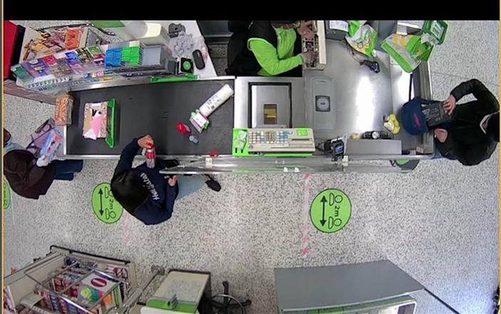 CCTV footage of Danyal Hussein in Asda in Colindale placing the knife block he bought into a plastic bag