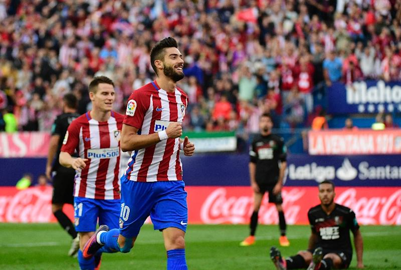 Yannick Carrasco scored a hat-trick in a 7-1 rout for leaders Atletico Madrid over Granada at the Vicente Calderon stadium on October 15, 2016 (AFP Photo/Pierre-Philippe Marcou)