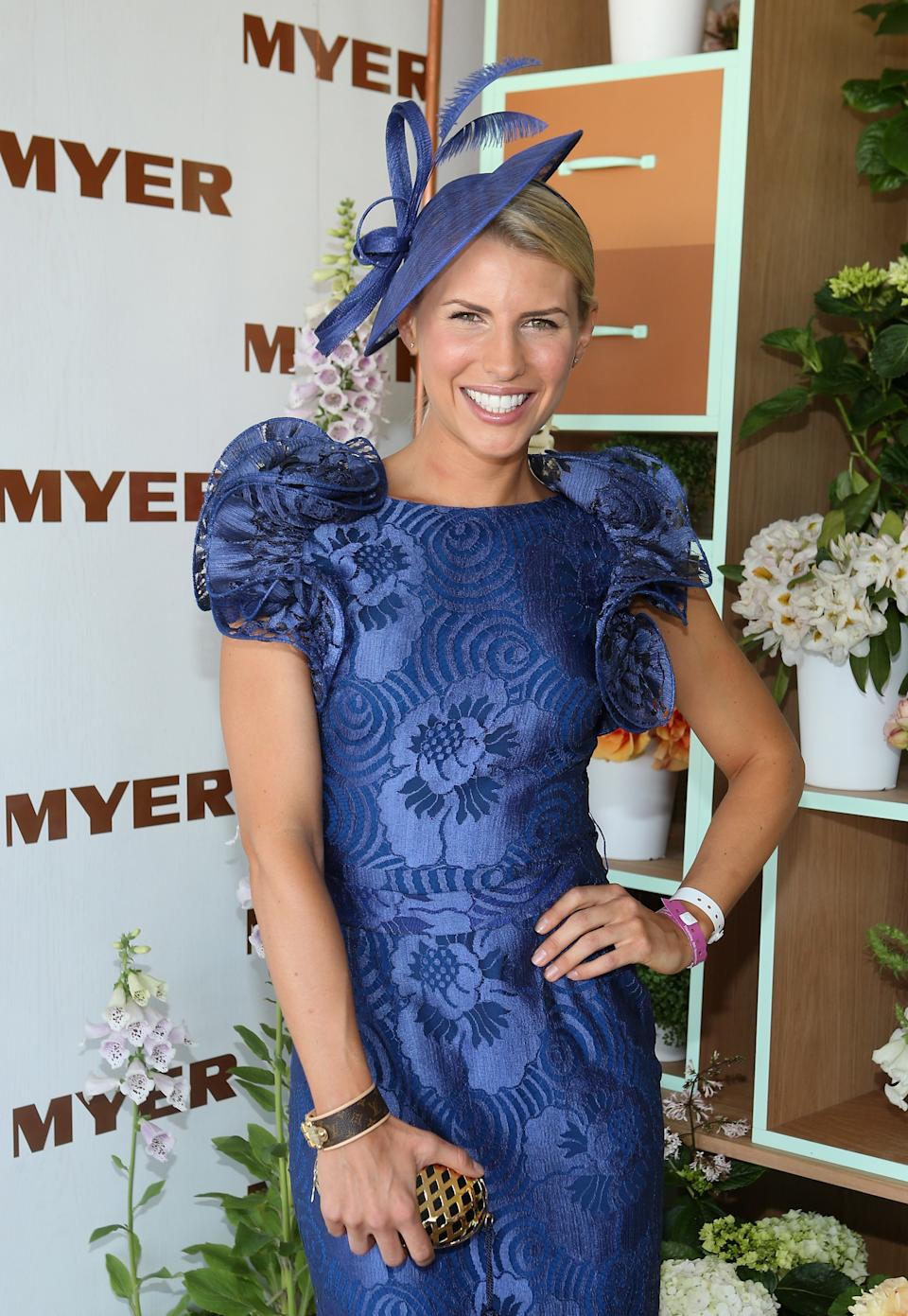 Tiffiny Hall wears a blue dress and hat at the Myer marquee on Crown Oaks Day at Flemington Racecourse on November 8, 2012 in Melbourne, Australia.  (Photo by Lucas Dawson/Getty Images)