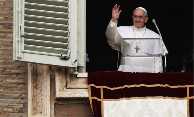 Pope Francis gives his first Angelus Blessing to the faithful from the window of his private residence on March 17 in Vatican City.