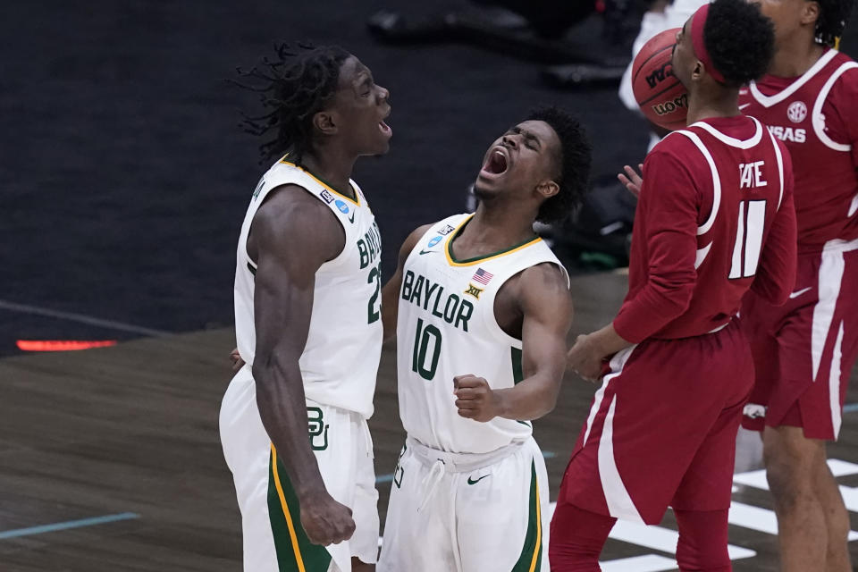Baylor forward Jonathan Tchamwa Tchatchoua, celebrates with teammate guard Adam Flagler (10) during the second half of an Elite 8 game against Arkansas in the NCAA men's college basketball tournament at Lucas Oil Stadium, Monday, March 29, 2021, in Indianapolis. (AP Photo/Darron Cummings)