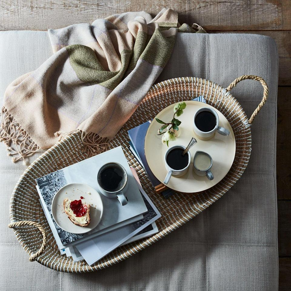 <p>This beautiful <span>Olli Ella Handwoven Natural Seagrass Basket Tray</span> ($17-$90) is a multipurpose solution for holding a stack of books, carrying breakfast, changing a baby, and more. With the sweet-smelling seagrass that gives it a unique texture and look, it makes a compliment-worthy home essential.</p>