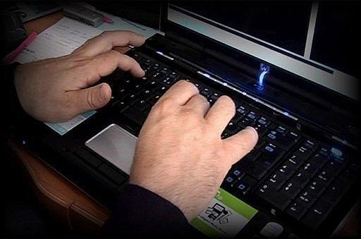 "A photo made available by the Child Exploitation and Online Protection Centre shows a police officer tracking paedophile's on the Internet. Police in several countries have arrested 184 alleged members of an online paedophile ring and rescued 230 children in ""the biggest case of its kind"", Europol said on Wednesday"