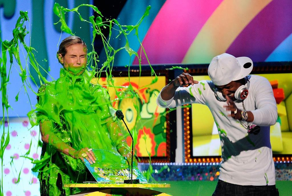 """Good sport of the week was """"Project Runway"""" host Heidi Klum, who got seriously slimed onstage at Nickelodeon's 24th Annual Kids' Choice Awards in Los Angeles, while a quick-footed Nick Cannon managed to jump out of the way! Kevork Djansezian/<a href=""""http://www.gettyimages.com/"""" target=""""new"""">GettyImages.com</a> - April 2, 2011"""