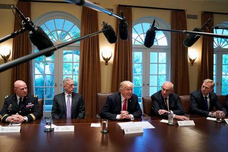 U.S. President Donald Trump (C) participates in a briefing with senior military leaders at the White House in Washington, U.S.