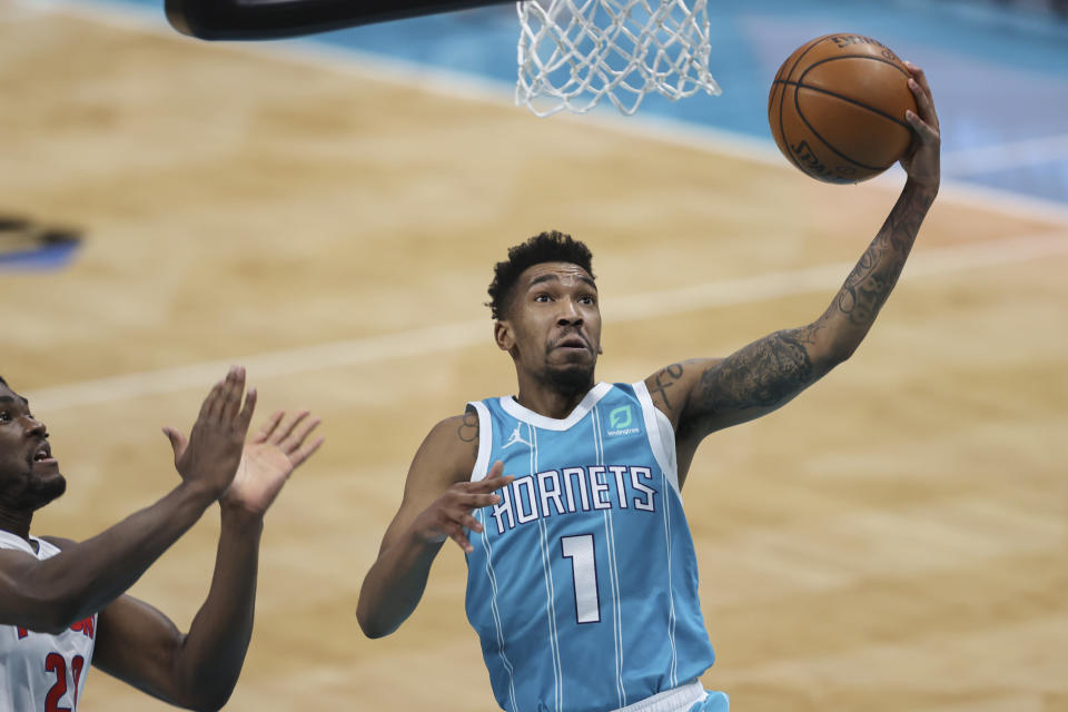 Charlotte Hornets guard Malik Monk (1) drives to the basket against the Detroit Pistons in the second half of an NBA basketball game in Charlotte, N.C., Saturday, May 1, 2021. (AP Photo/Nell Redmond)