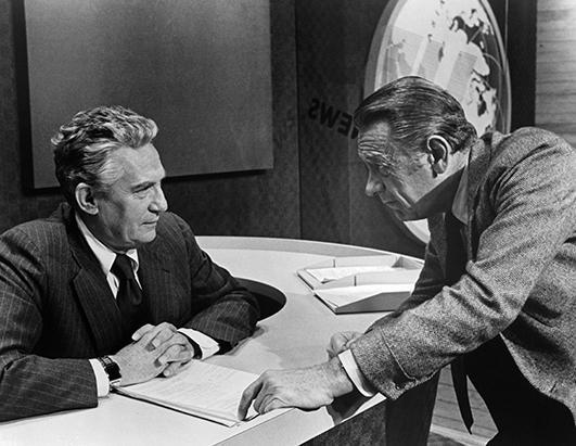"""Actor Peter Finch and William Holden on set of the MGM movie """"Network"""" in 1976"""