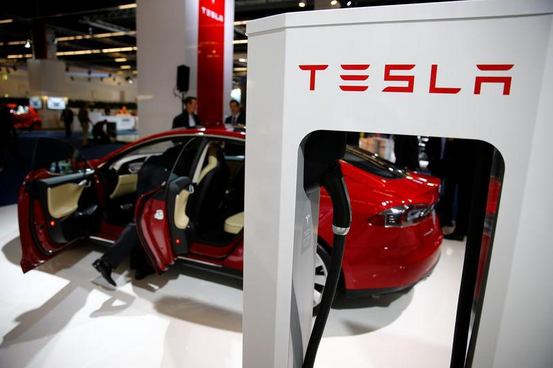 FILE PHOTO: A Tesla model S car with an electric vehicle charging station is displayed at Frankfurt Motor Show