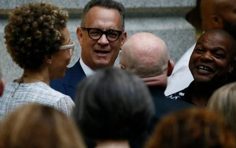 Artists Sherald and Wiley gather with Hanks prior to unveiling of Obamas' portraits at the Smithsonian - Credit: Reuters