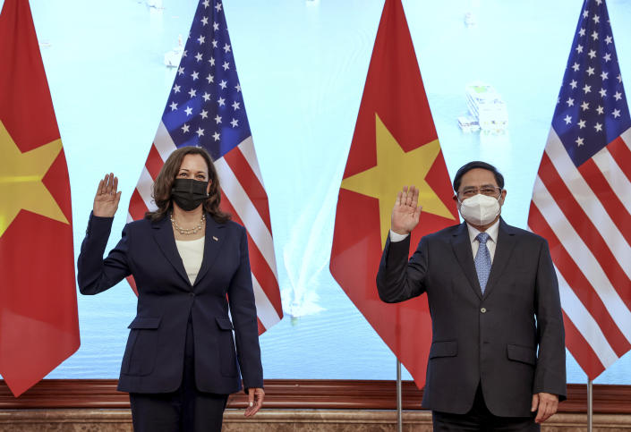 U.S. Vice President Kamala Harris meets Vietnam's Prime Minister Pham Minh Chinh during a meeting at the Office of Government in Hanoi, Vietnam, Wednesday, Aug. 25, 2021. (Evelyn Hockstein/Pool Photo via AP)