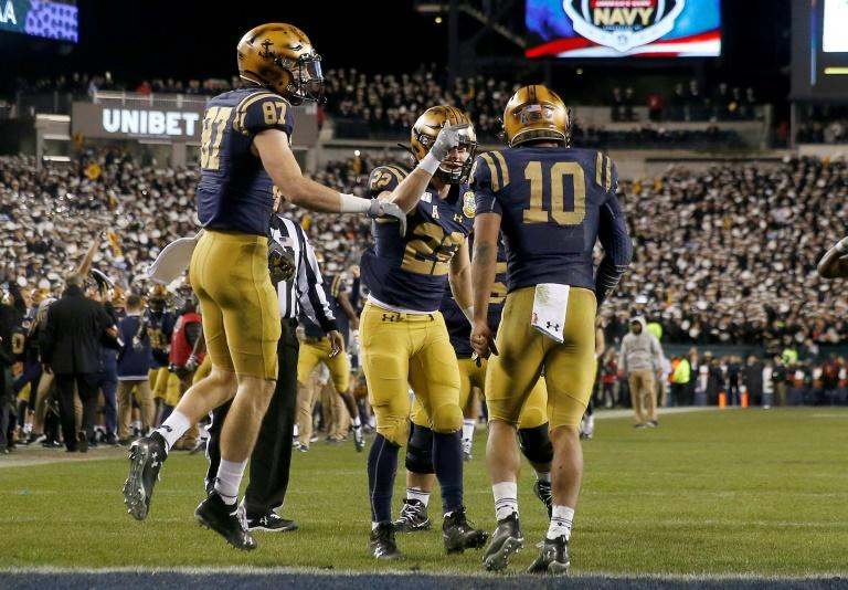 The Navy Midshipmen celebrate a touchdown in Saturday's game against the Army Black Knights