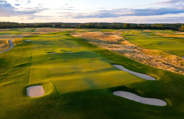 """<div class=""""caption""""> GEOMETRY CLASS: The par-4 ninth at Arcadia Bluffs South has a putting service that resembles side-by-side Biarritz greens. </div>"""