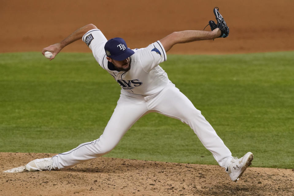 Tampa Bay Rays starting pitcher Ryan Thompson throws against the Los Angeles Dodgers during the eighth inning in Game 3 of the baseball World Series Friday, Oct. 23, 2020, in Arlington, Texas. (AP Photo/Tony Gutierrez)