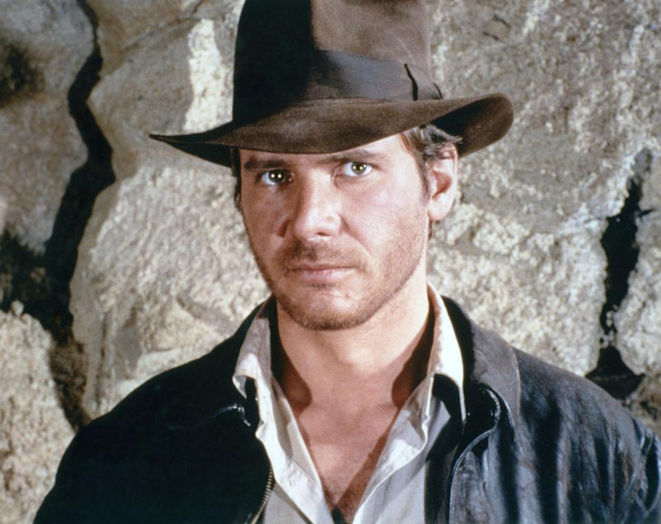 """American actor Harrison Ford on the set of """"Raiders of the Lost Ark"""". (Photo by Sunset Boulevard/Corbis via Getty Images)"""