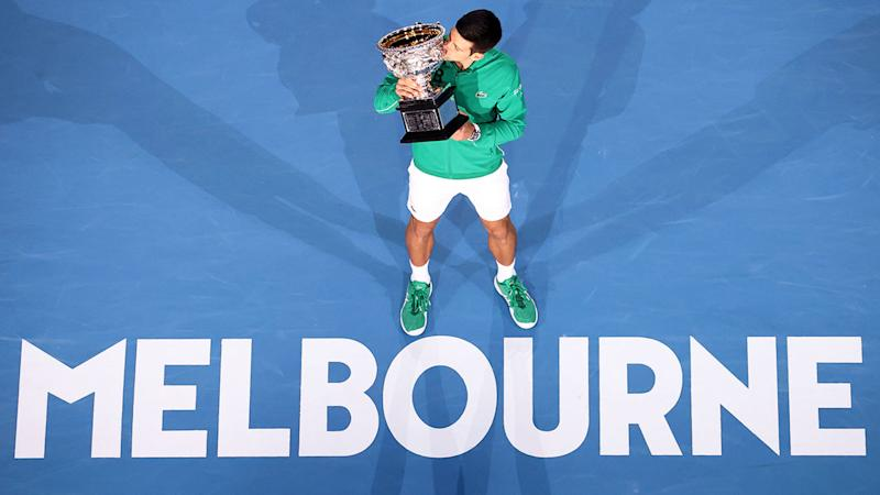 2020 Australian Open champion Novak Djokovic poses with the trophy at Melbourne Park.