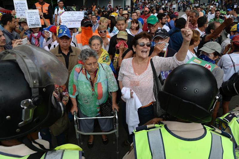 """Opposition activists shout slogans during the so-called """"march of the grand-parents"""" protest against the government in Caracas on May 12, 2017 (AFP Photo/FEDERICO PARRA                      )"""