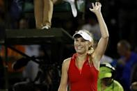 Mar 28, 2017; Miami, FL, USA; Caroline Wozniacki of Denmark waves to the crowd after her match against Lucie Safarova of the Czech Republic (not pictured) on day eight of the 2017 Miami Open at Crandon Park Tennis Center. Wozniacki won 6-4, 6-3. Geoff Burke-USA TODAY Sports