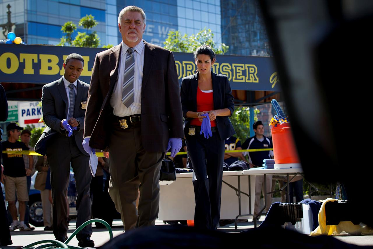 "Lee Thompson Young, Bruce McGill, and Angie Harmon in the ""Rizzoli & Isles"" episode, ""Over/Under."""