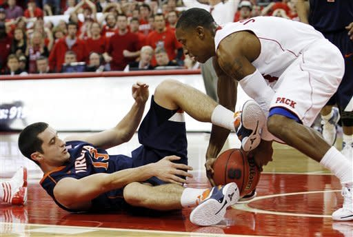 Virginia guard Sammy Zeglinski (13) struggles for possession of the ball against North Carolina State guard Alex Johnson (3) during the second half of an NCAA college basketball game in Raleigh, N.C., Saturday, Jan. 28, 2012. Virginia won 61-60. (AP Photo/Jim R. Bounds)