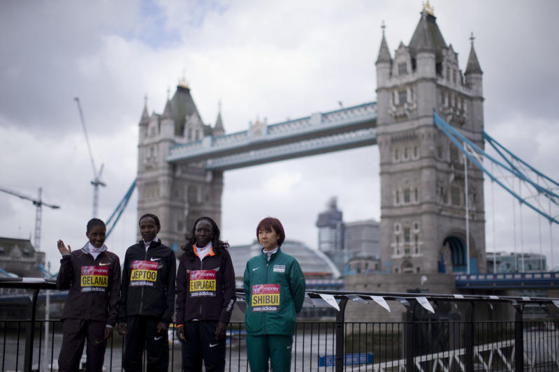 Elite women's marathon runners, from left, Ethiopia's Tiki Gelana, Kenya's Priscah Jeptoo, Kenya's Edna Kiplagat and Japan's Yoko Shibui pose for photographs during a media opportunity for the London Marathon backdropped by Tower Bridge in London, Thursday, April 18, 2013. The London Marathon will go ahead on Sunday despite security fears in the wake of the bomb blasts in the Boston race that killed at least three runners and injured many more. (AP Photo/Matt Dunham)