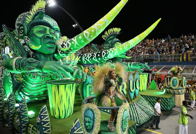 <p>Dancers from the Unidos do Peruche samba school perform on a float during a carnival parade in Sao Paulo, Brazil, Saturday, Feb. 10, 2018. (Photo: Andre Penner/AP) </p>