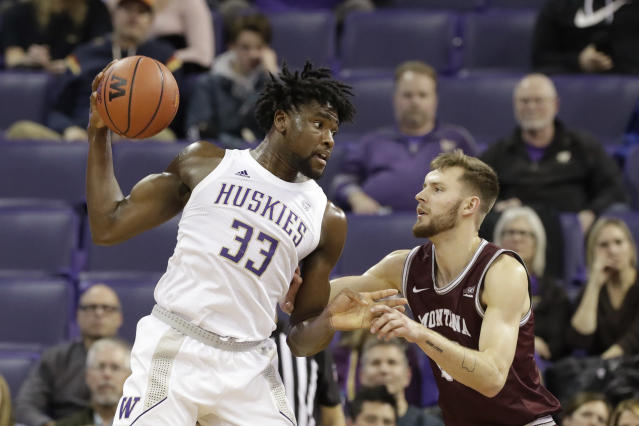 Washington's Isaiah Stewart (33) is defended by Montana's Mack Anderson during the second half of an NCAA college basketball game Friday, Nov. 22, 2019, in Seattle. Washington won 73-56. (AP Photo/Elaine Thompson)
