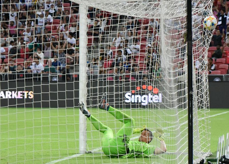 Juventus goalkeeper Wojciech Szczesny falls into the goal net after conceding Harry Kane's goal in their International Champions Cup match against Tottenham at the National Stadium. (PHOTO: Zainal Yahya/Yahoo News Singapore)