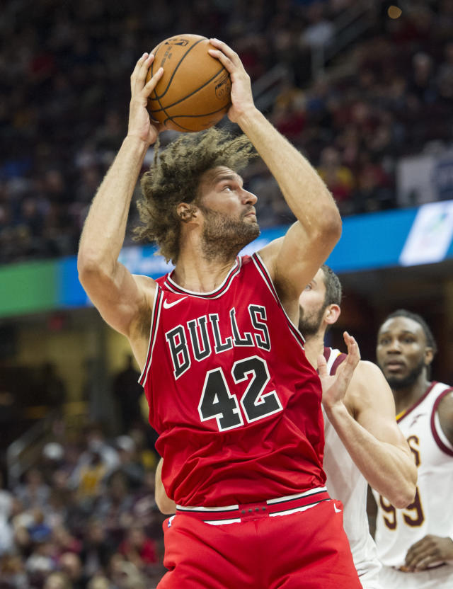 Chicago Bulls' Robin Lopez (42) drives past Cleveland Cavaliers' Kevin Love during the first half of an NBA preseason basketball game in Cleveland, Tuesday, Oct. 10, 2017. (AP Photo/Phil Long)