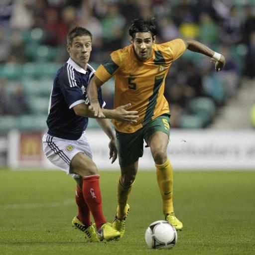 Ian Black (L) of Scotland vies with Rhys Williams (R) of Australia during the international friendly football match at Easter Road Stadium in Edinburgh, Scotland. Scotland won 3-1 over Australia