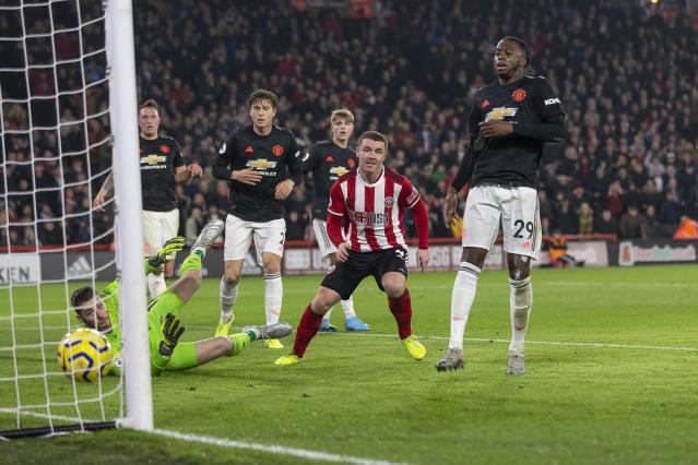 Fleck finds the back of the net as Manchester United players watch on (Photo by Daniel Chesterton/Offside/Offside via Getty Images)