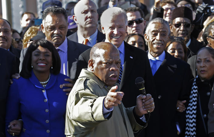 Rep. John Lewis, D-Ga., points to where he and others were beaten 48 years ago when they tried to cross the Edmund Pettus Bridge during a civil rights march in Selma, Ala., Sunday, March 3, 2013. At rear is Vice President Joe Biden. At left is U/S. Rep. Terri Sewell, D-Ala., Jesse Jackson is second from left. (Photo: Dave Martin/AP)