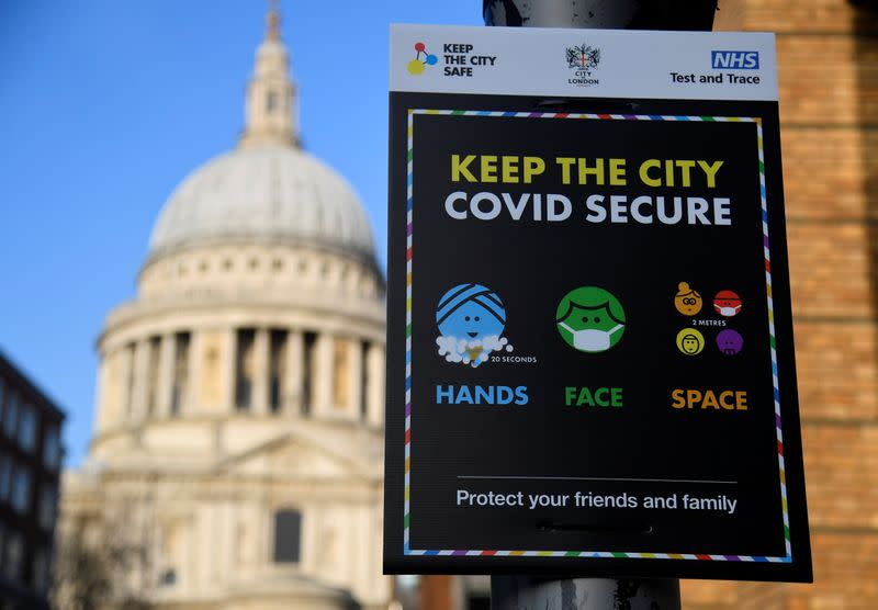 A public health information sign is seen with St. Paul's Cathedral seen behind amidst a lockdown during the spread of the coronavirus disease (COVID-19) pandemic, London, Britain